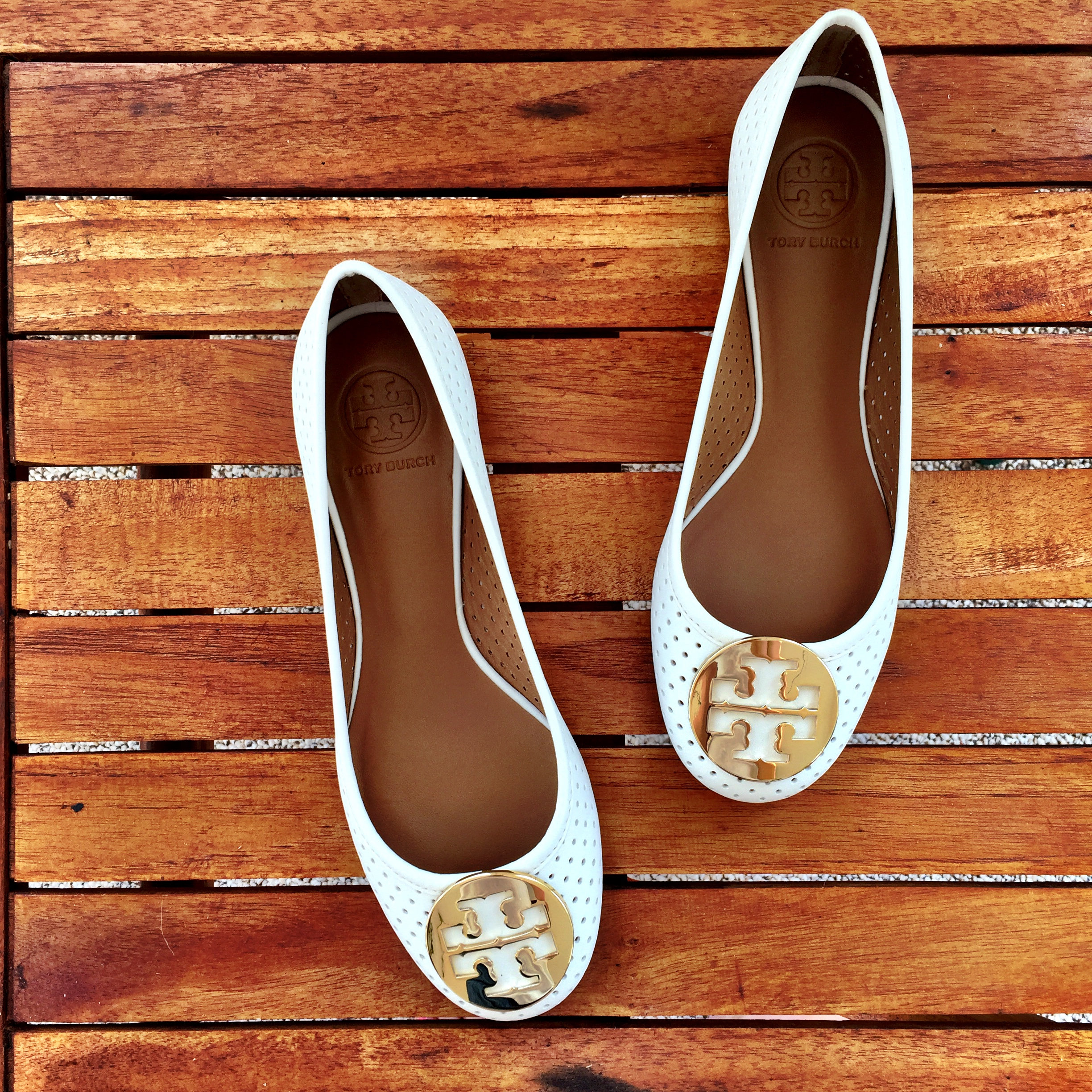 these white tory burch flats are perfect for summer, and the perforated  material allows circulation as well. i recently purchased white espadrille  wedges ...