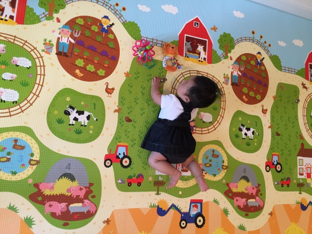 penny doing tummy time on her pororo mat